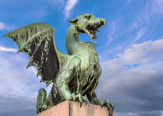 A sculpture of a green dragon on Dragon Bridge, in Ljubljana, Slovenia